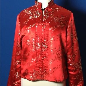 Reversible red satin and black velvet jacket.